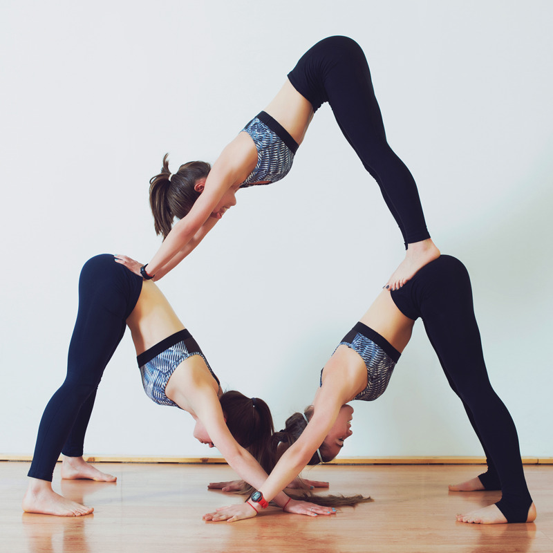 Yoga pose group of three